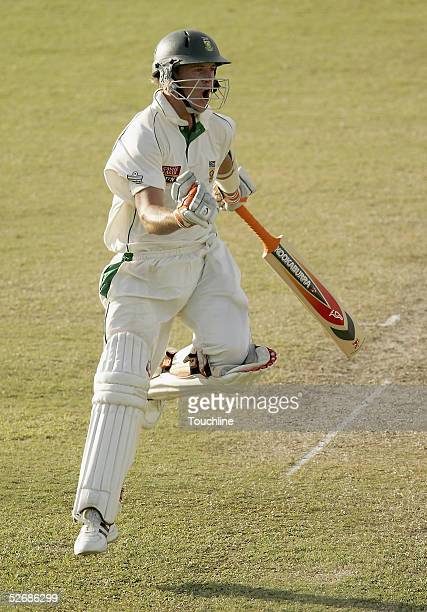De Villiers of South Africa celebrates his century during day two of the Third Test between the West Indies and South Africa at Kensington Oval on...