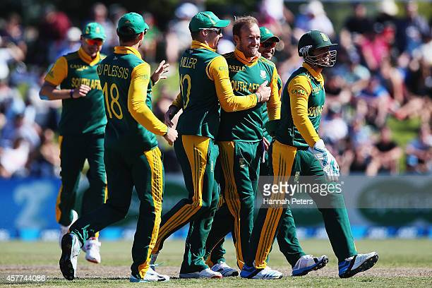 De Villiers of South Africa celebrates the wicket of Tom Latham of New Zealand during the One Day International match between New Zealand and South...
