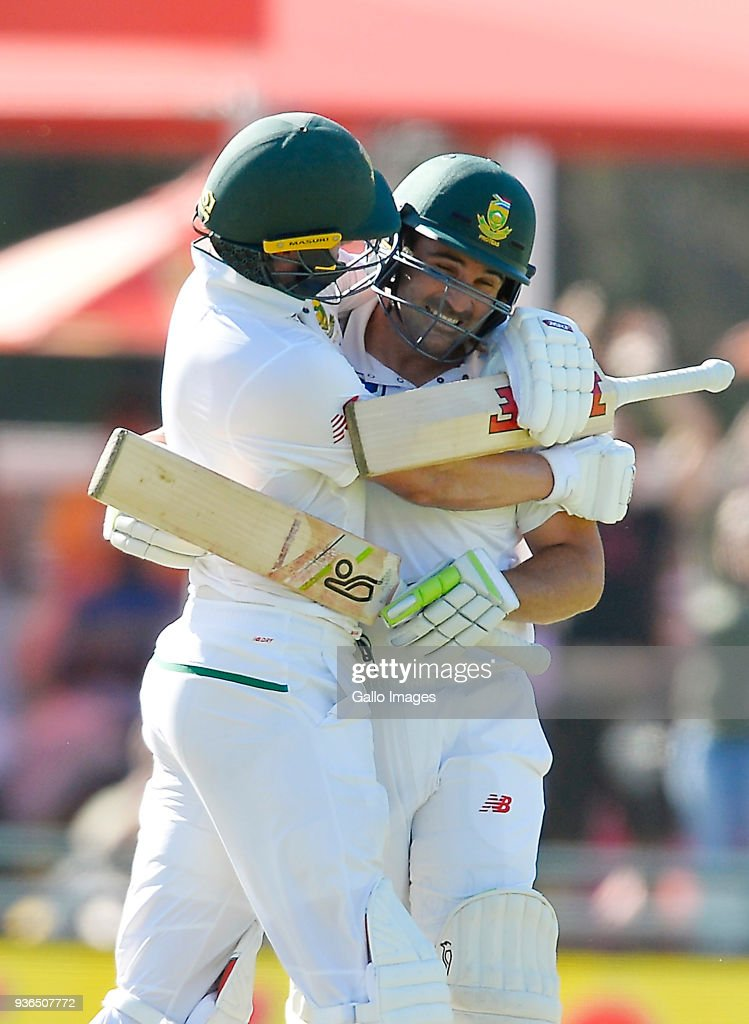 AB de Villiers of South Africa celebrates with Dean Elgar of South Africa after scoring 100 runs during day 1 of the 3rd Sunfoil Test match between South Africa and Australia at PPC Newlands on March 22, 2018 in Cape Town, South Africa.