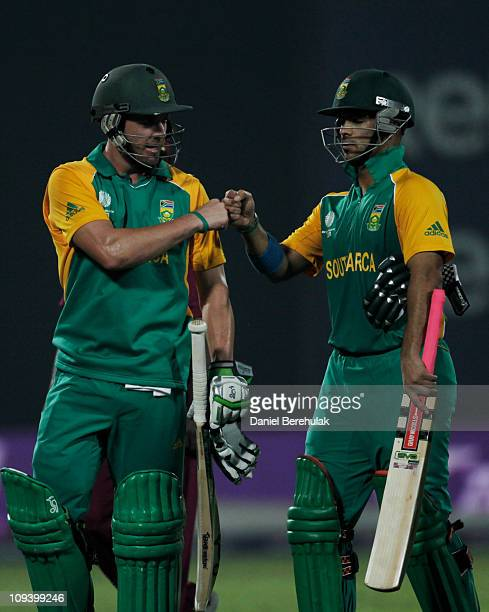 AB de Villiers of South Africa celebrates with team mate JeanPaul Duminy aftertheir victory during the 2011 ICC World Cup Group B match between West...