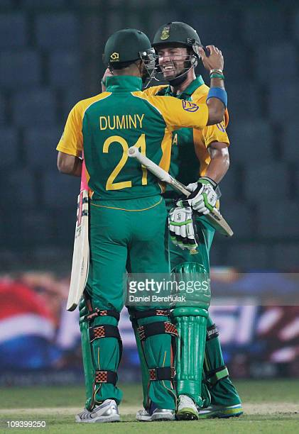 AB de Villiers of South Africa celebrates with team mate JeanPaul Duminy on scoring the winning runs during the 2011 ICC World Cup Group B match...