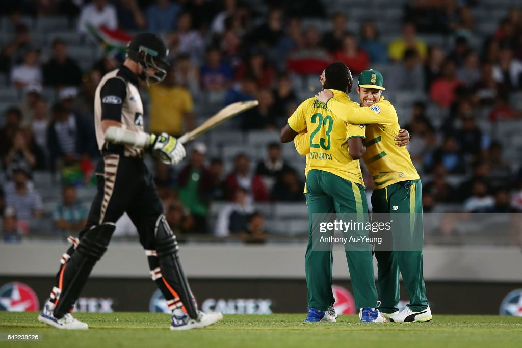 AB de Villiers of South Africa celebrates with teammates for the wicket of Mitchell Santner of New Zealand during the first International Twenty20 match between New Zealand and South Africa at Eden Park on February 17, 2017 in Auckland, New Zealand.