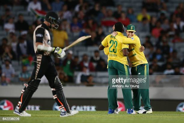 AB de Villiers of South Africa celebrates with teammates for the wicket of Mitchell Santner of New Zealand during the first International Twenty20...