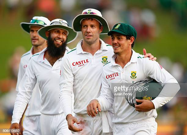 AB de Villiers of South Africa congratulates Quinton de Kock of South Africa after his century earlier in the day during day two of the 4th Test at...