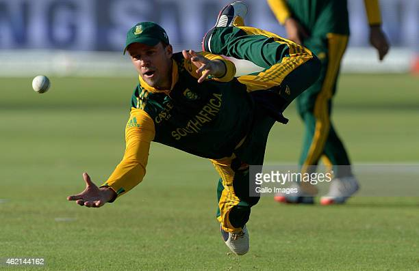 AB de Villiers of South Africa drops Andre Russell on 40 during the 4th Momentum ODI between South Africa and West Indies at St Georges Park on...