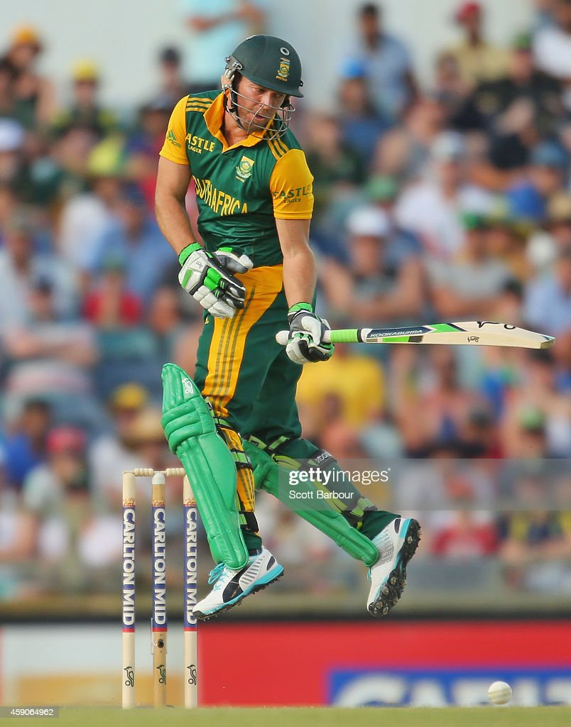 AB de Villiers of South Africa fends off a short delivery from Mitchell Johnson of Australia during the One Day International match between Australia and South Africa at WACA on November 16, 2014 in Perth, Australia.