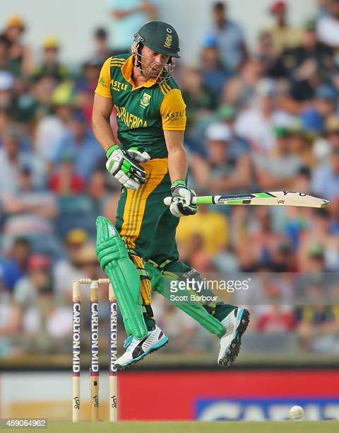 AB de Villiers of South Africa fends off a short delivery from Mitchell Johnson of Australia during the One Day International match between Australia...