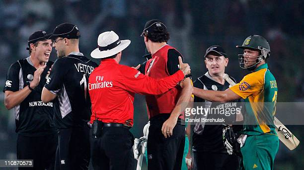 AB de Villiers of South Africa has words with New Zealand players after having been run out by Martin Guptill of New Zealand during the 2011 ICC...