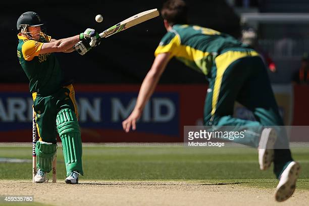 AB de Villiers of South Africa hits the ball to the boundary off the bowling of Pat Cummins during game four of the One Day International series...