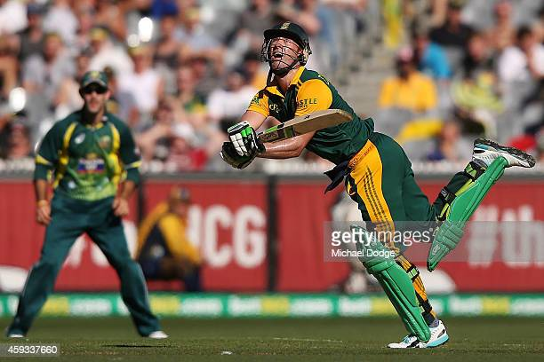 AB de Villiers of South Africa is caught out after top edging a pull shot off the bowling of Pat Cummins of Australia during game four of the One Day...