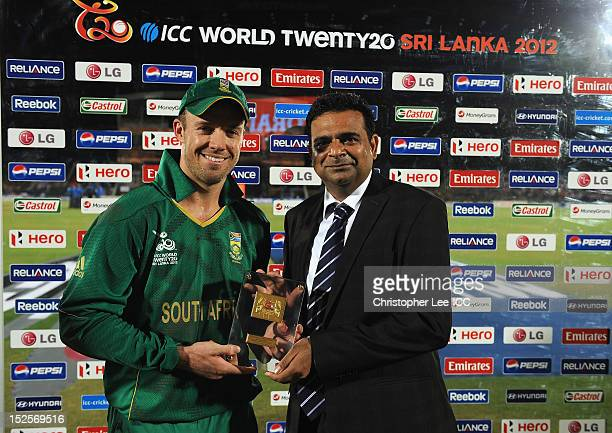 De Villiers of South Africa is handed his Player of the Match award by Mr Sohit of Pepsi during the ICC World Twenty20 2012 Group C match between Sri...