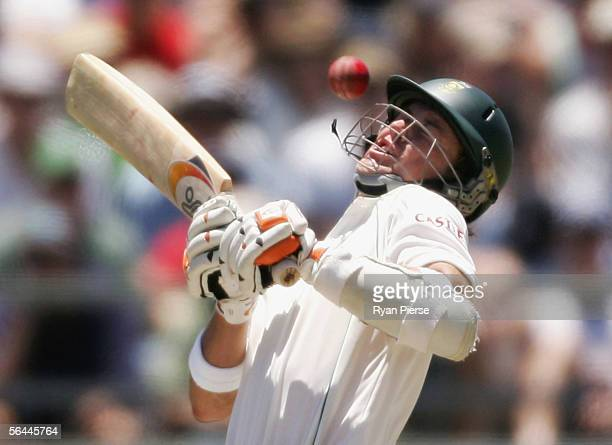 AB de Villiers of South Africa is it hit by a bouncer bowled by Brett Lee of Australia during day two of the First Test between Australia and South...