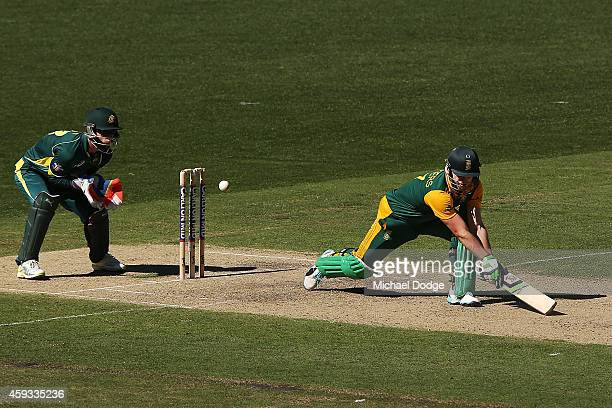 AB de Villiers of South Africa plays a reverse sweep past Mathew Wade of Australia off the bowling of Glenn Maxwell during game four of the One Day...
