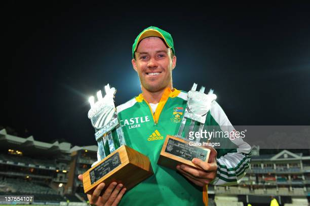 De Villiers of South Africa pose with the Series trophy and Man of the Series trophy after the 5th ODI match between South Africa and Sri Lanka from...