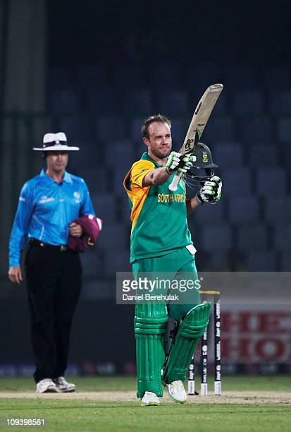 AB de Villiers of South Africa raises his bat after reaching his century during the 2011 ICC World Cup Group B match between West Indies and South...
