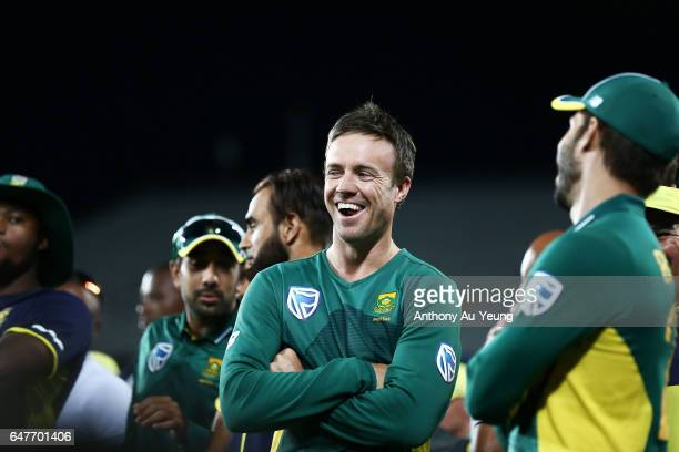 AB de Villiers of South Africa shares a laugh with teammates after winning game five of the One Day International series between New Zealand and...