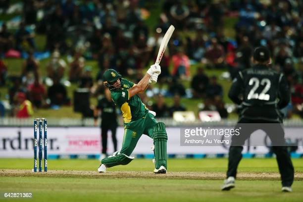 AB de Villiers of South Africa smashes a six to win the First One Day International match between New Zealand and South Africa at Seddon Park on...