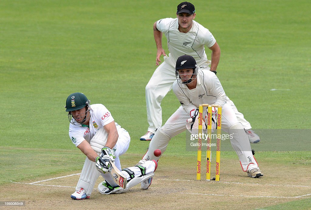 AB de Villiers of South Africa sweeps a delivery during day 1 of the 2nd Test match between South Africa and New Zealand at Axxess St Georges on January 11, 2013 in Port Elizabeth, South Africa