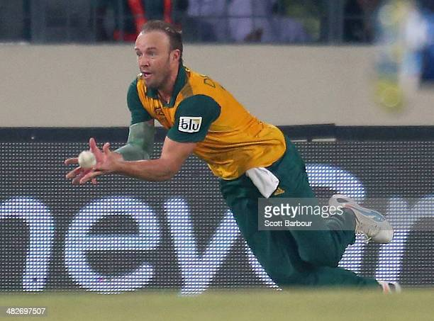De Villiers of South Africa takes a catch to dismiss Yuvraj Singh of India during the ICC World Twenty20 Bangladesh 2014 2nd Semi-Final match between...