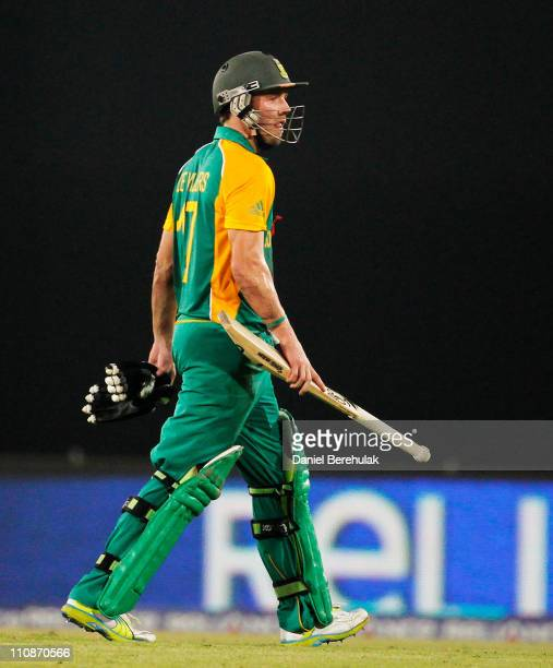 De Villiers of South Africa walks back to the pavillion after having been run out by Martin Guptill of New Zealand during the 2011 ICC World Cup...