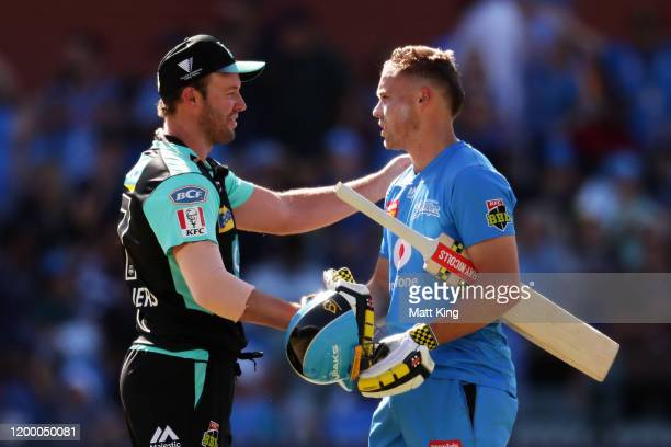 AB de Villiers of the Heat congratulates Phil Salt of the Strikers after he hit the winning runs during the Big Bash League match between the...