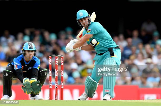 De Villiers of the Heat hits the ball to the boundary for a four during the Big Bash League match between the Brisbane Heat and the Adelaide Strikers...