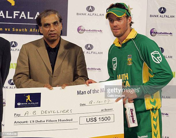 AB de Villiers recieves the Man of the Match cheque during the first ODI match between Pakistan and South Africa held at Gaddafi Stadium on October...