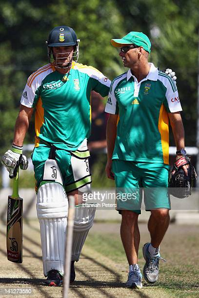 De Villiers talks with head coach Gary Kirsten in the nets at Seddon Park on March 14 2012 in Hamilton New Zealand