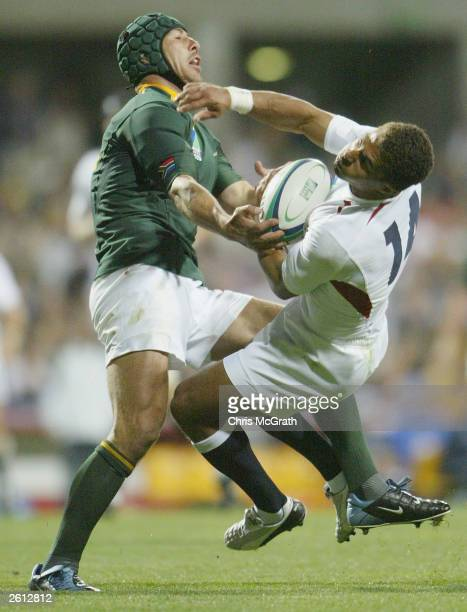 De Wet Barry of South Africa smashes Jason Robinson of England during the Rugby World Cup Pool C match between South Africa and England at Subiaco...