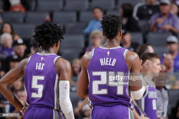 De'Aaron Fox and Buddy Hield of the Sacramento Kings look on during the game against the Washington Wizards on October 29 2017 at Golden 1 Center in...
