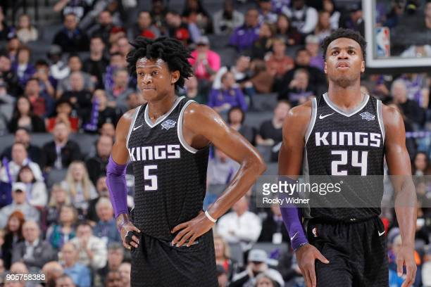 De'Aaron Fox and Buddy Hield of the Sacramento Kings look on during the game against the Los Angeles Clippers on January 11 2018 at Golden 1 Center...