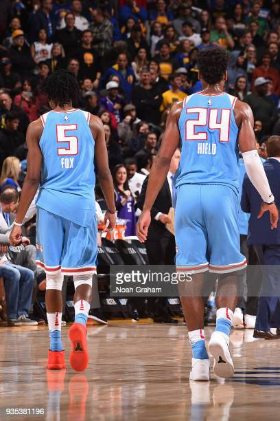 De'Aaron Fox and Buddy Hield of the Sacramento Kings look on during the game against the Golden State Warriors on March 16 2018 at ORACLE Arena in...