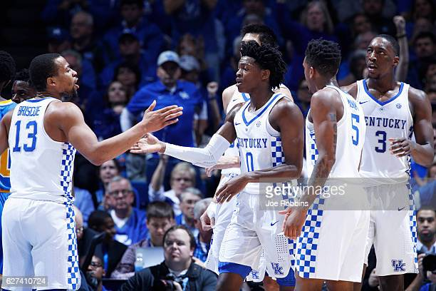 De'Aaron Fox and Isaiah Briscoe of the Kentucky Wildcats celebrate in the first half of the game against the UCLA Bruins at Rupp Arena on December 3...