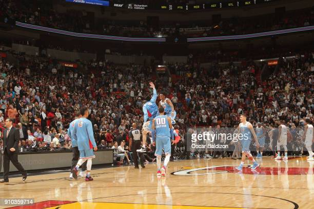 De'Aaron Fox and Kosta Koufos of the Sacramento Kings celebrate a win against the Miami Heat on January 25 2018 at American Airlines Arena in Miami...