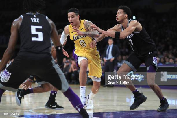 De'Aaron Fox and Skal Labissiere of the Sacramento Kings defend against Kyle Kuzma of the Los Angeles Lakers during the second half of a game at...