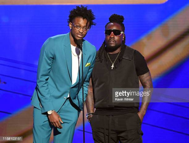 De'Aaron Fox and Wale speak onstage during the 2019 NBA Awards presented by Kia on TNT at Barker Hangar on June 24, 2019 in Santa Monica, California.
