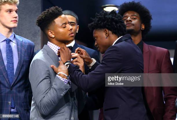 De'Aaron Fox helps adjust the bowtie of Markelle Fultz before the first round of the 2017 NBA Draft at Barclays Center on June 22 2017 in New York...