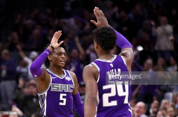 De'Aaron Fox highfives Buddy Hield of the Sacramento Kings during their game against the Portland Trail Blazers at Golden 1 Center on January 14 2019...