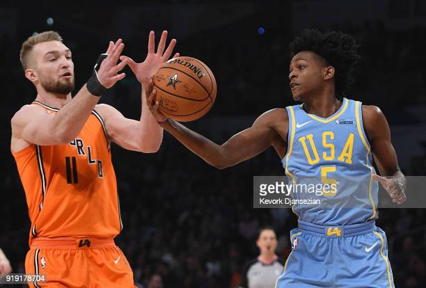 De'Aaron Fox of Team USA steals the ball from Domantas Sabonis of the World Team during the 2018 Mountain Dew Kickstart Rising Stars Game at Staples...