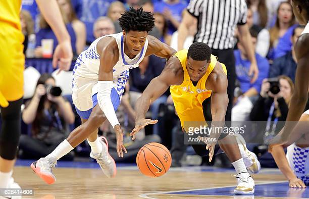 De'Aaron Fox of the Kentucky Wildcats and Max Joseph of the Valparaiso Crusadersreach for a loose ball during the game at Rupp Arena on December 7...