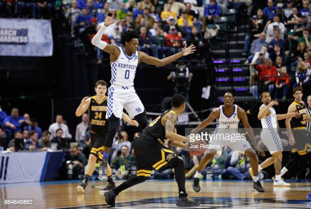 De'Aaron Fox of the Kentucky Wildcats defends Lavone Holland II of the Northern Kentucky Norse in the first half during the first round of the 2017...