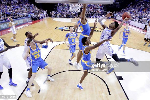 De'Aaron Fox of the Kentucky Wildcats drives to the basket against Ike Anigbogu of the UCLA Bruins in the first half during the 2017 NCAA Men's...