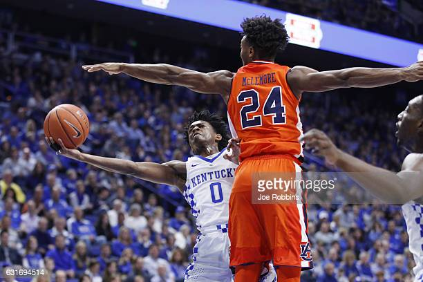De'Aaron Fox of the Kentucky Wildcats drives to the basket against Anfernee McLemore of the Auburn Tigers in the first half of the game at Rupp Arena...