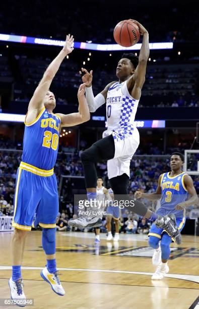 De'Aaron Fox of the Kentucky Wildcats drives to the basket against Bryce Alford of the UCLA Bruins in the second half during the 2017 NCAA Men's...
