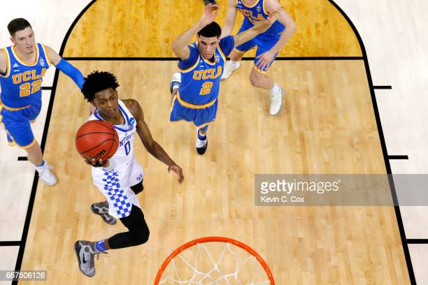 De'Aaron Fox of the Kentucky Wildcats drives to the basket against Lonzo Ball of the UCLA Bruins in the first half during the 2017 NCAA Men's...