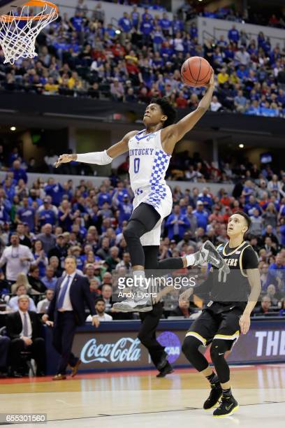 De'Aaron Fox of the Kentucky Wildcats dunks against Landry Shamet of the Wichita State Shockers in the second half during the second round of the...