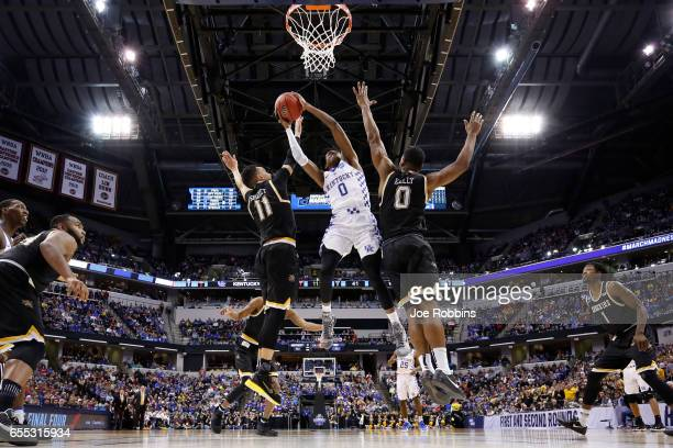 De'Aaron Fox of the Kentucky Wildcats goes to the basket against Rashard Kelly and Landry Shamet of the Wichita State Shockers during the second...