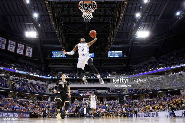 De'Aaron Fox of the Kentucky Wildcats goes up for a dunk ahead of Landry Shamet of the Wichita State Shockers during the second round of the 2017...