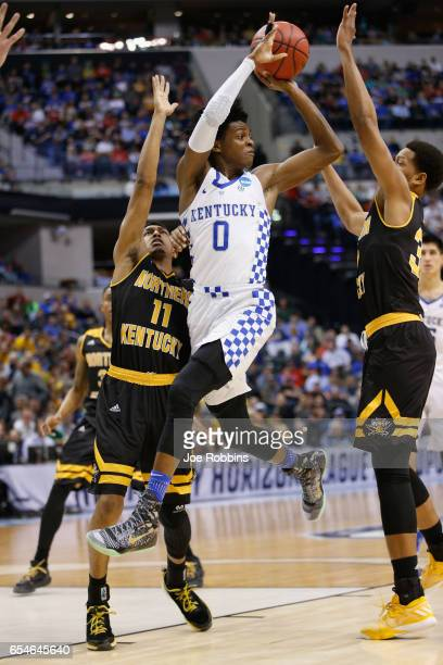 De'Aaron Fox of the Kentucky Wildcats looks to pass the ball in the first half against the Northern Kentucky Norse during the first round of the 2017...