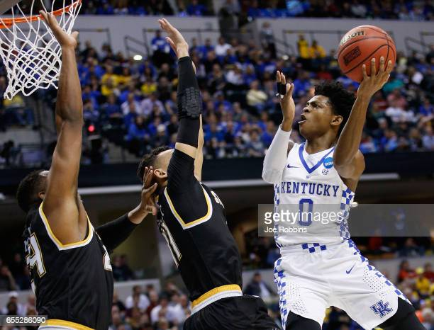 De'Aaron Fox of the Kentucky Wildcats shoots against Landry Shamet and Shaquille Morris of the Wichita State Shockers in the first half during the...